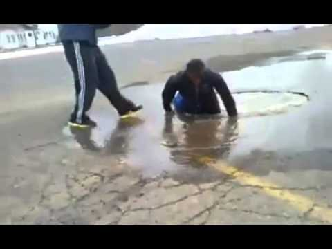 Guy Jumps and Falls into deep puddle! Very Funny!