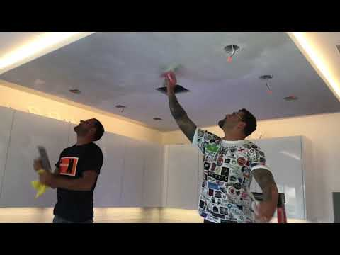 Venetian plaster clean white ceiling. Wearing company logo shirt that represents all trades in IG
