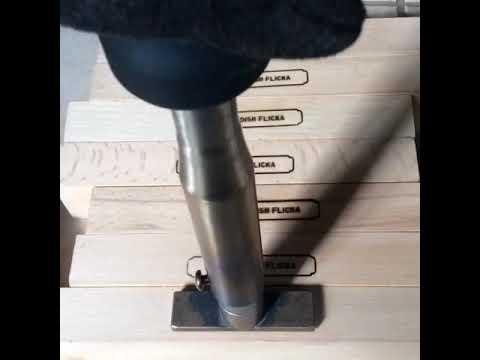 Branding the wooden Looms...