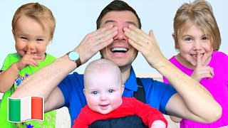 Cinque Bambini giocano a nascondino con papà