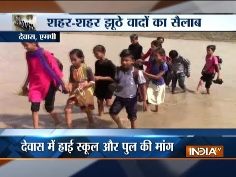 Madhya Pradesh: Children take risk to cross flooded river to reach school