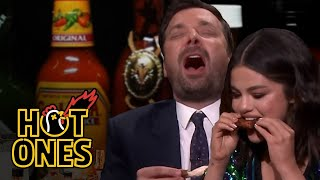 Jimmy fallon invites hot ones host sean evans over to the show eat spicy wings together with selena gomez. however, cannot handle spice and esse...