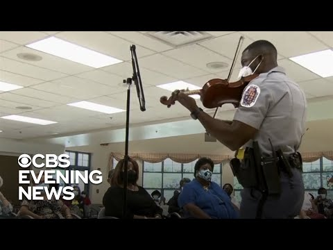 Cop and violinist uses music to bring people together