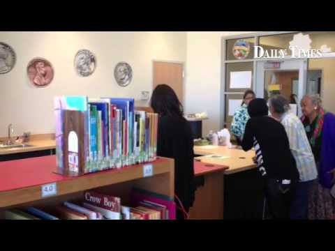 Visitors check out the library inside the new Naschitti Elementary School