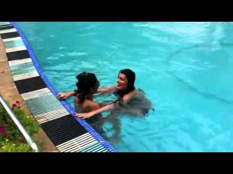 Lesbians Kissing In A Pool
