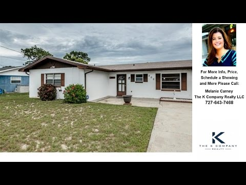 209 BABSON DRIVE, BABSON PARK, FL Presented by Melanie Carney.