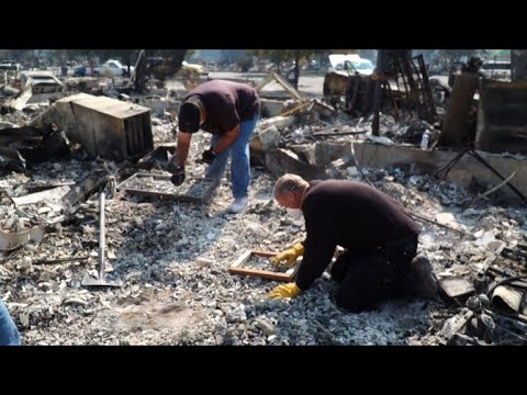 California residents search for belongings among wildfire ashes