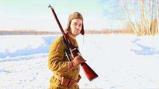 Фотосессия в военном стиле с костром и винтовкой