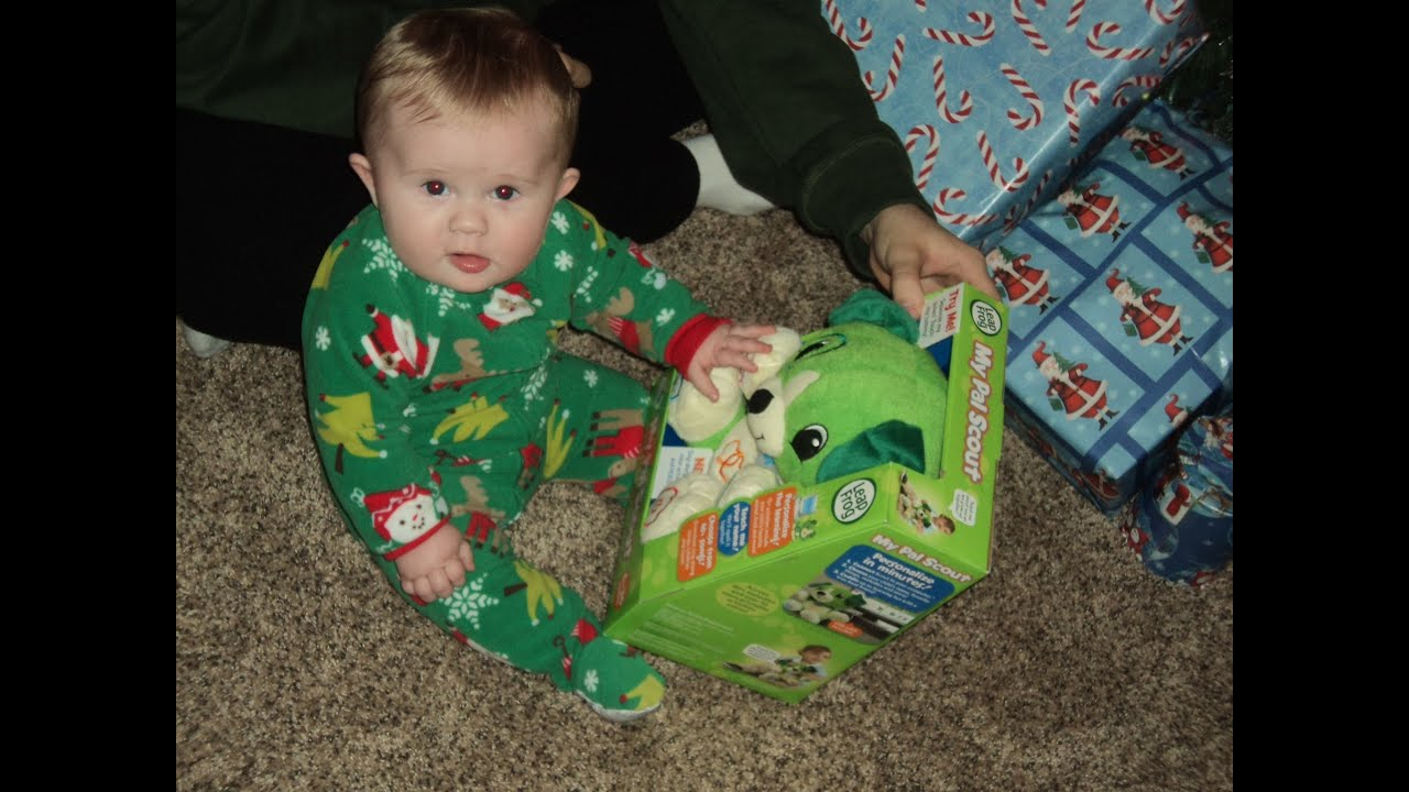 baby noah opening up presents on christmas morning