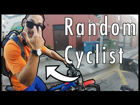 Biker Chats With Cyclist