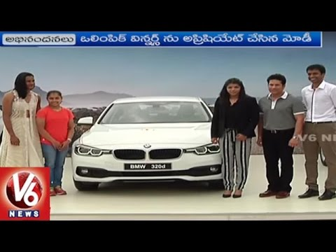 PM Narendra Modi Meets Sindhu, Sakshi And Dipa | Sachin Presents BMW Cars | V6 News