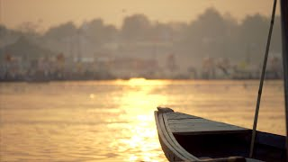 Beautiful landscape view of sunrise / sunset at banks of the river Ganga in India