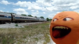 The Stupid Orange In Here Comes The Amtrak Train