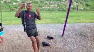 Boy gets stuck in baby swing.