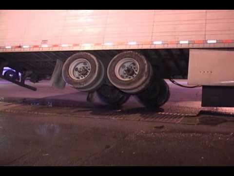 Chicago,IL (Bizarre Accident) Large Semi Truck & Trailer Stuck On the Top  of a Bridge