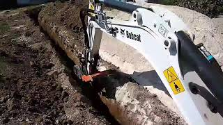 Bobcat E20 digging trench