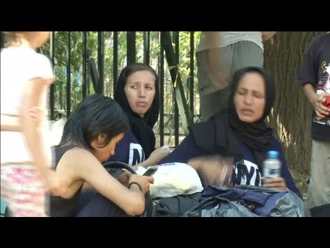Stranded Afghan migrants moved from park to reception centre in Greek capital - #NewsVideo