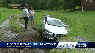 Plum hit by flooding strong enough to move cars