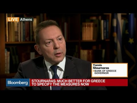 Bank of Greece's Stournaras says it's better to specify Greek debt relief measures now