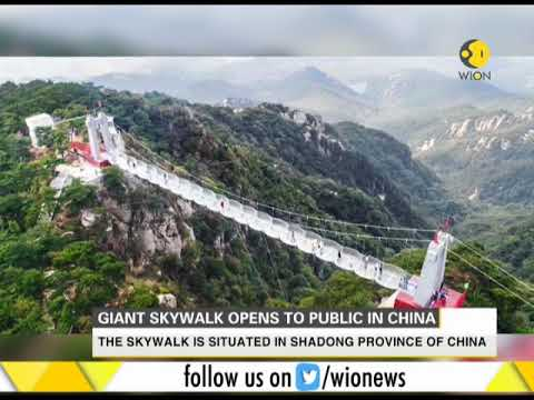 Skywalk made of wire cable and toughened glass opens to public in China