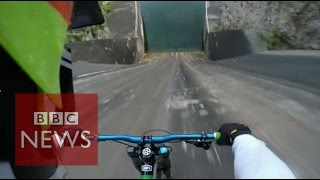 Biker films insane 60m bike dam drop in Slovenia  - BBC News