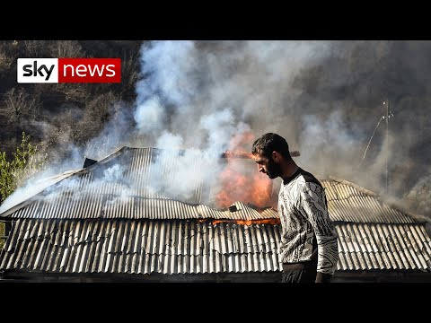 Nagorno-Karabakh: Armenian homes burned down in defiance