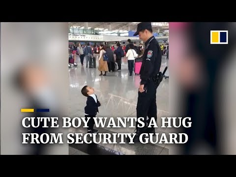 Cute boy wants a hug from security guard