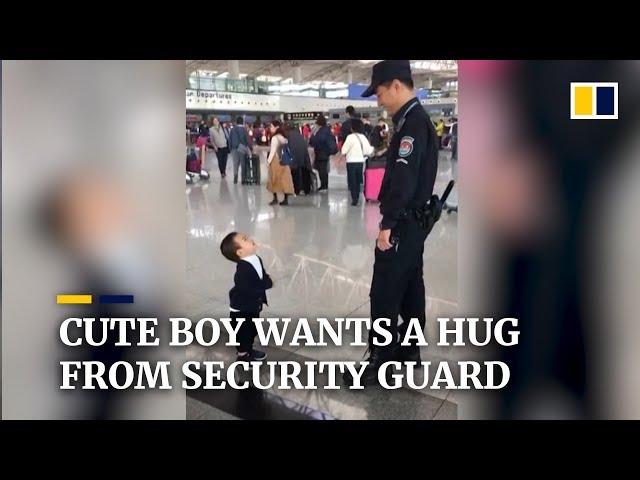 Cute boy wants a hug from security guard