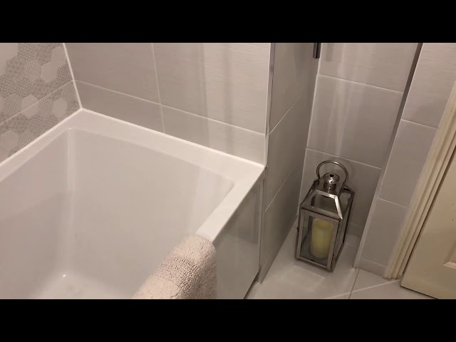 Small bathroom with shower bath