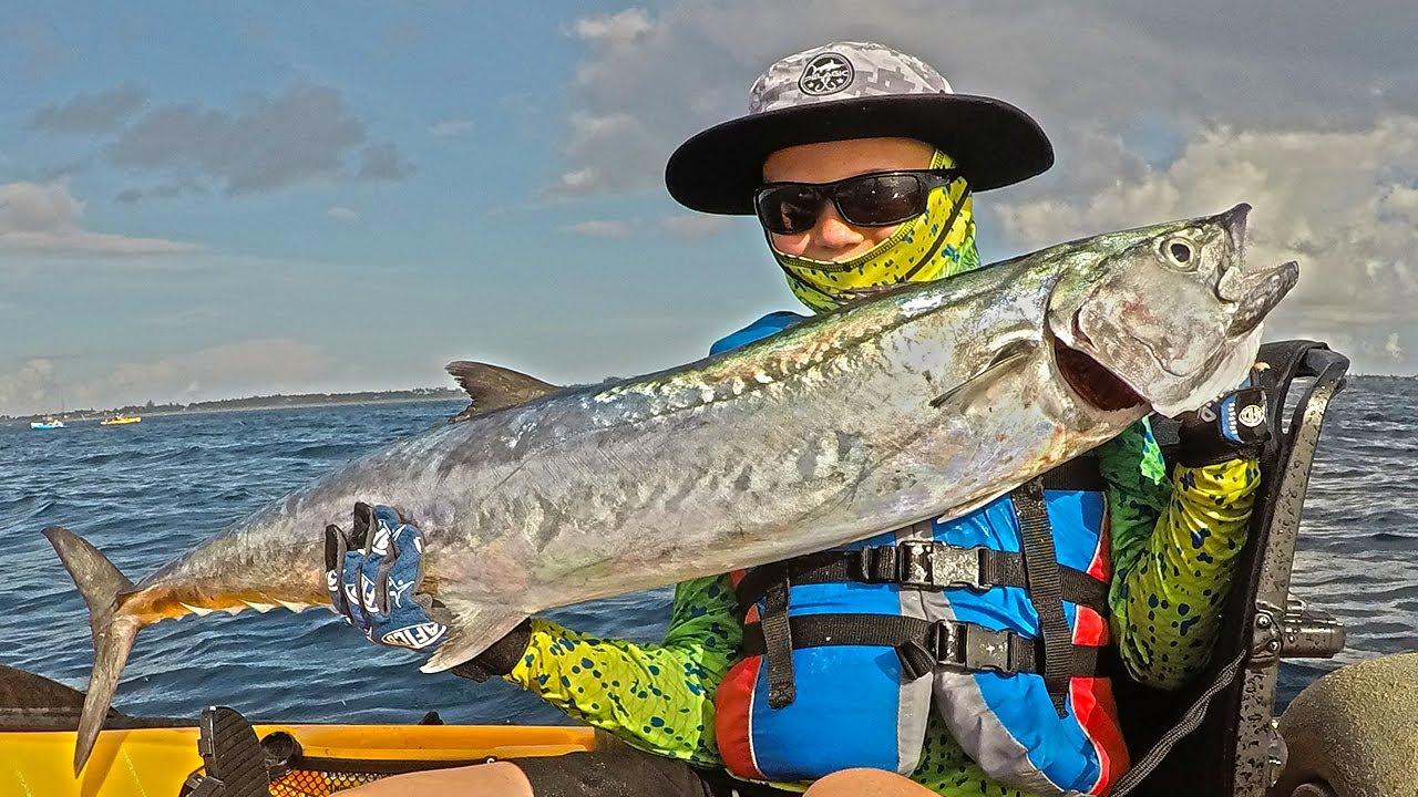Junior angler age 10 landing a smoker king mackerel from for Deep blue kayak fishing