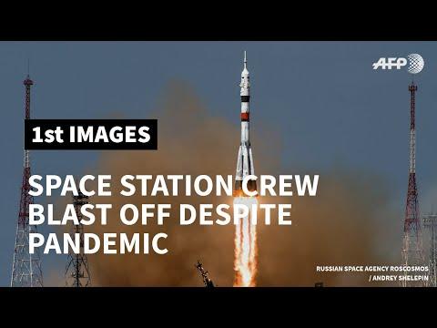 AFP News Agency: Space station crew blast off despite virus-hit build up | AFP