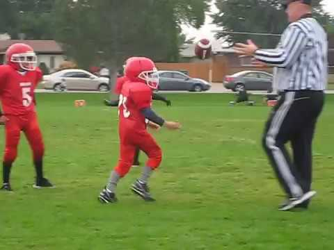 Little kid does a frontflip into the endzone