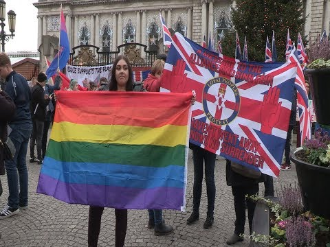 LGBT rights activists defy flags protesters provocation