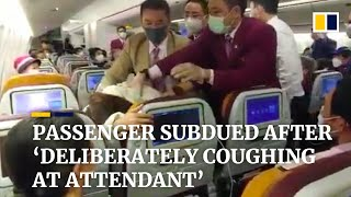 Flight attendant subdues passenger after she 'deliberately coughed' at staff in China