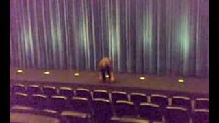 Freak is dancing on the stage of a big cinema!