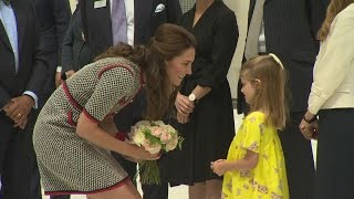 adorable six year old presents kate with flowers at va museum