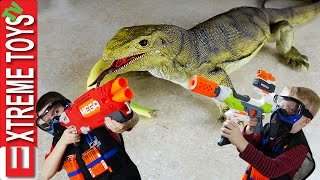 wild monitor lizard stow away part 2 giant lizard toy attacks boys fight back with nerf blasters