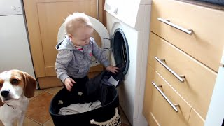 Dog And Baby Learning How To Do The Laundry