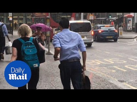 Londoners Dash For Cover As RAIN Makes Surprise Comeback