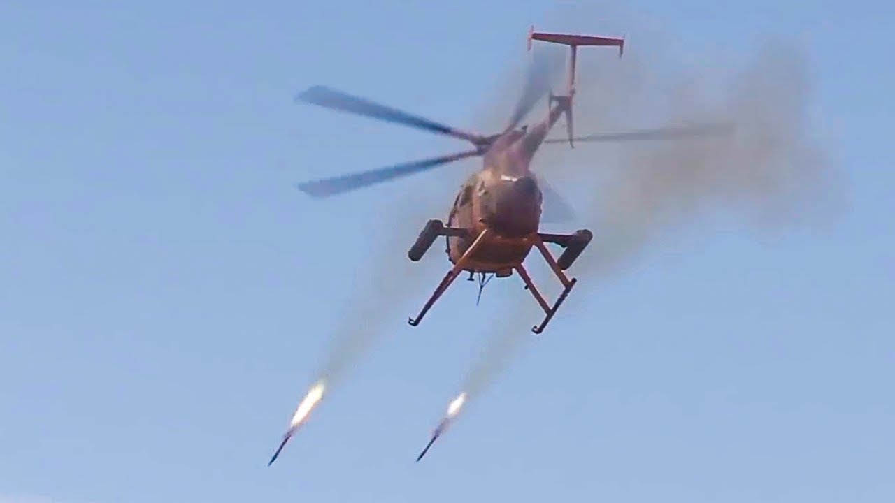 Attack Helicopter Firing Rockets