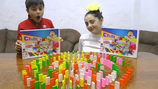 Guka and Maria pretend play with  Dominoes