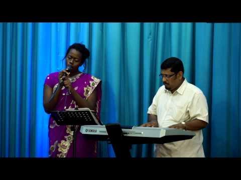 American Girl Singing A Christian malayalam Song Nithya Snehathal. By. Emily Rachael Atunrase