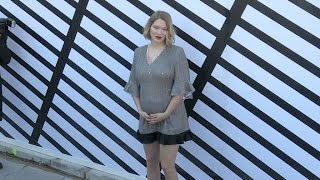 Pregnant Lea Seydoux proudly shows her baby bump at the Louis Vuitton Ready to Wear Fashion Show