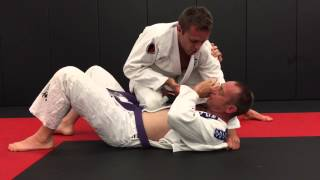 Renzo Gracie Black Belt shows Modified Baseball Choke from Side Control