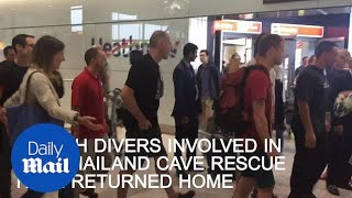 British divers involved in Thai cave rescue return home - Daily Mail