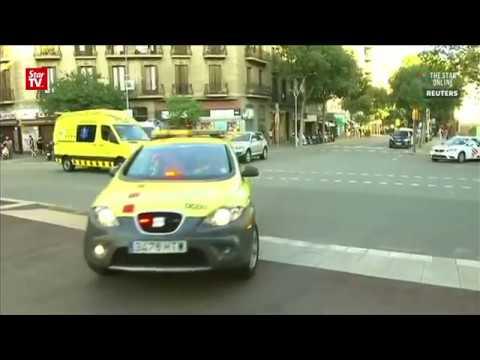 Police says Barcelona van attacker may still be at large