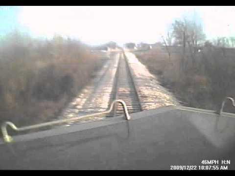 Train hits dump truck, locomotive cab video