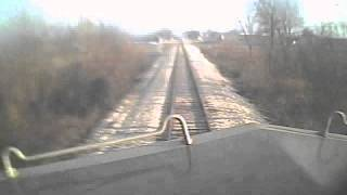 Train hits dump truck, locomotive cab video