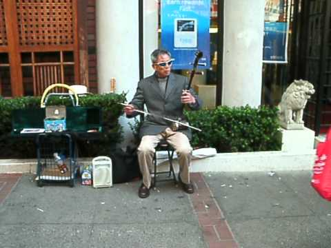 San Francisco  Playing a different musical instrument