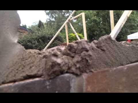 how to brick to a building line on a brick wall
